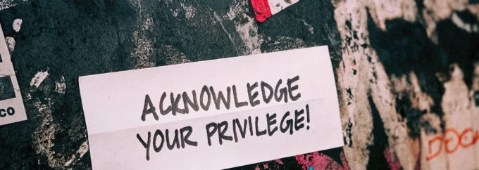 The words 'Acknowledge Your Privilege' are set against a black, white and red background.