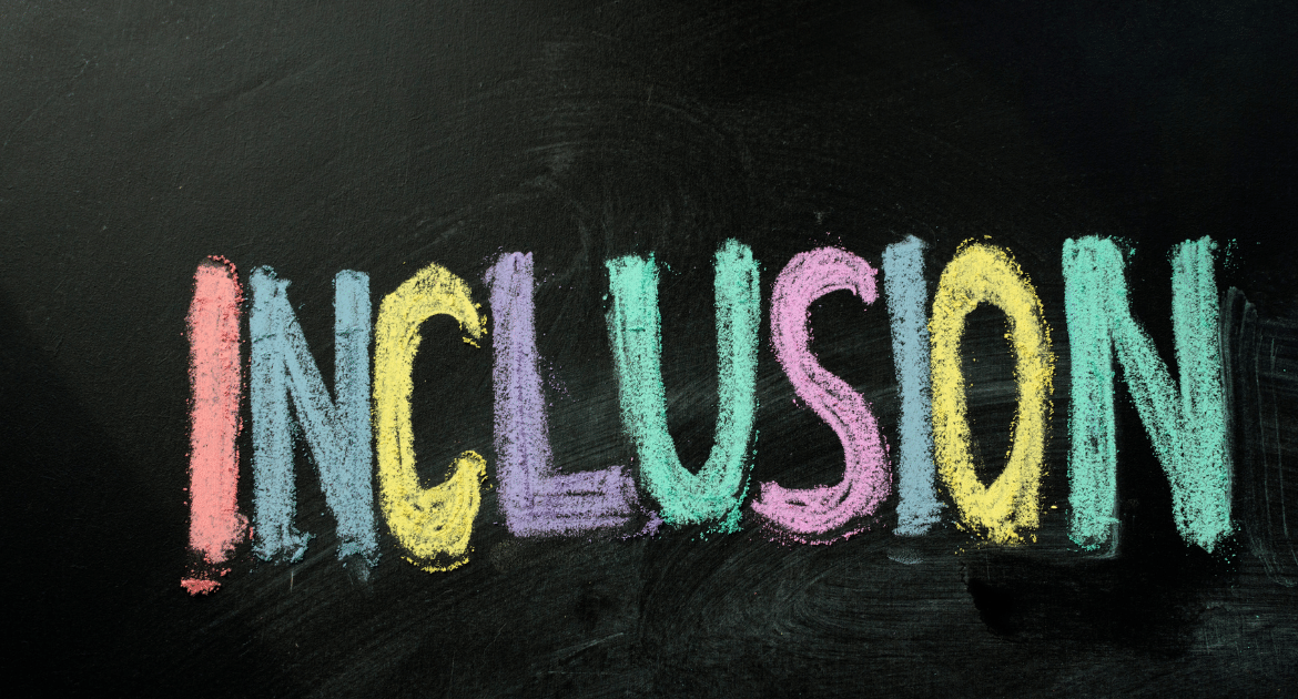 A blackboard with the word 'inclusion' written in coloured chalk.