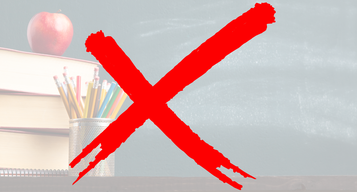 A red cross covers a faded picture of books, a tin of pencils and an apple in front of a blackboard.